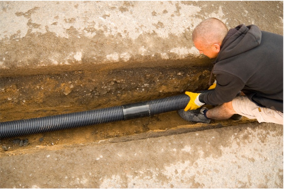 laying the black snake drain coil in the ground